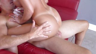 Wanton blonde August Ames with round natural tits knows how to stroke and suck an eager cock