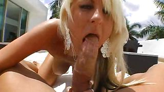 Vigorous Emilianna with massive natural tits is sucking hunk's chili dog and getting fucked from the back