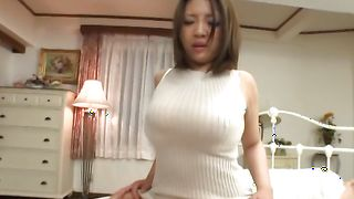 Charming gal Conomi with curvy tits is sucking buddy's shaft while he is quietly moaning from pleasure