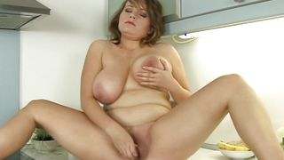Gorgeous busty Karen Newman is horny and she enjoys sucking a huge dangler