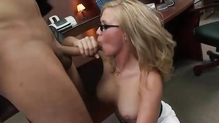 Voluptous blonde Dylan Riley with great tits is grabbing her boobs while sucking a packing monster