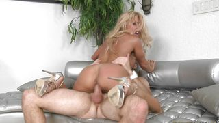 Overwhelming busty blonde Gina West gobbles up a fat packing monster