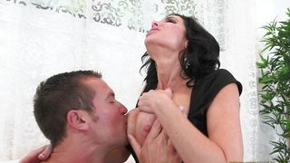 Guy holds voluptous Veronica Avluv with firm tits tight while roughly penetrating her