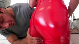 Alluring busty redhead Aria Xcite receives an invigorating fingering while giving an eager blowjob