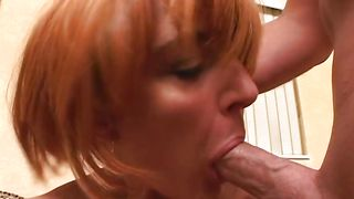 Alluring redhead Jenna with great tits is sucking and fucking like a real pro in a room