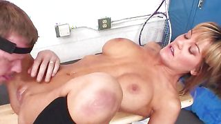 Sex appeal Megan Monroe with round tits blows a big dick before being impaled on it