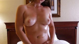 Sweet brunette minx Sierra with curvy natural tits lets a man take her clothes off